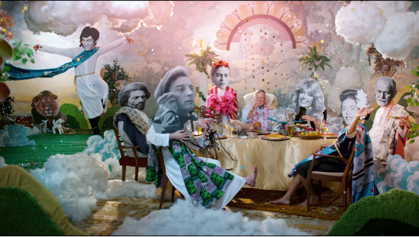 A group of famous people sitting around a dinner table in the heaven imagined in Dick Johnson is Dead