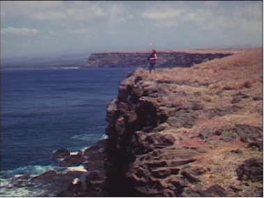 A woman at cliff's edge in Halving the Bones