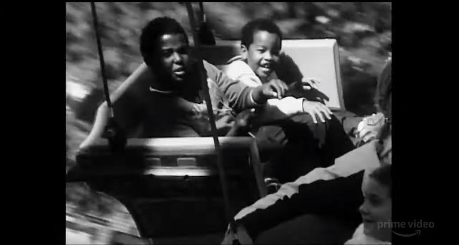 2 kids enjoying a ride at an amusement park in Garret Bradley's Time